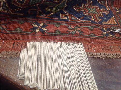 , un tapis en cours de ru00e9paration, avec les diffu00e9rentes u00e9tapes de ...